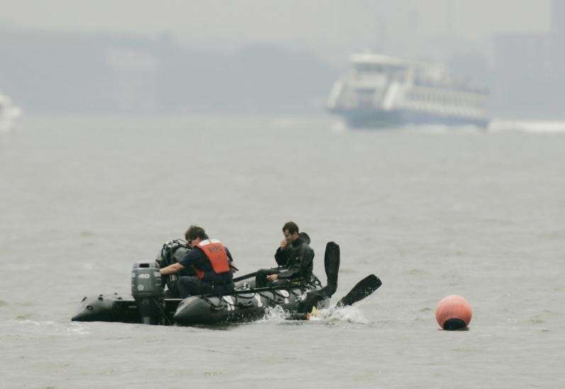 A diver goes into the Hudson River near