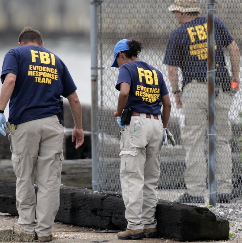 Investigators search along the Hudson River shore in