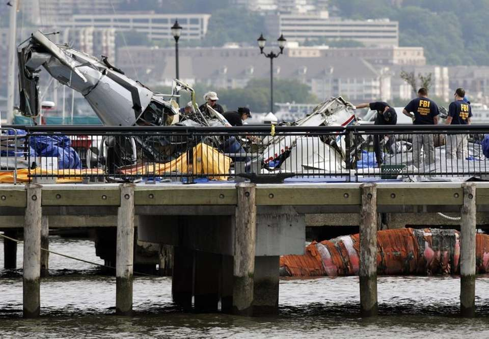 Investigators examine the wreckage of an airplane near
