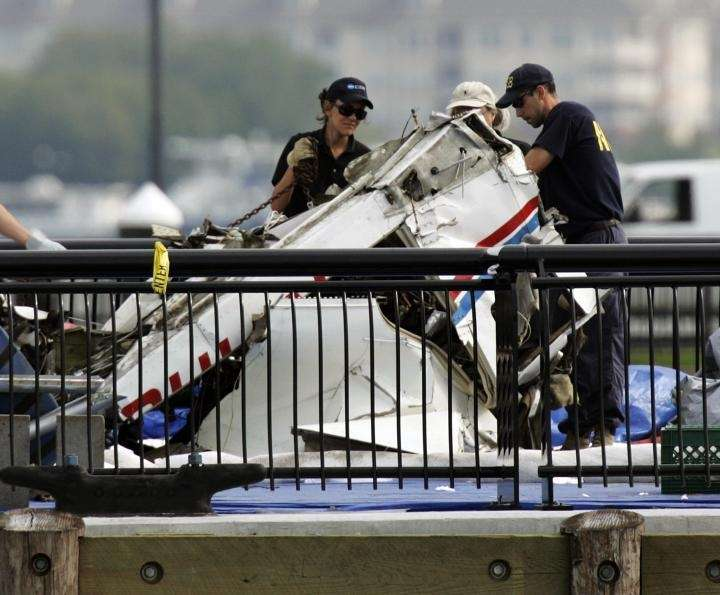 Investigators examine the wreckage of an airplane on