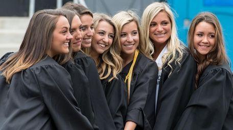 Graduates pose at St. Joseph's College's 98th commencement