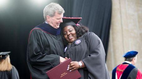 Graduates embrace Robert C. Houlihan, vice president for