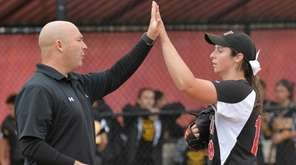 East Islip head coach Jason McGowan high-fives pitcher
