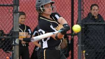 Commack's Nicole Principe swings at the fastball by