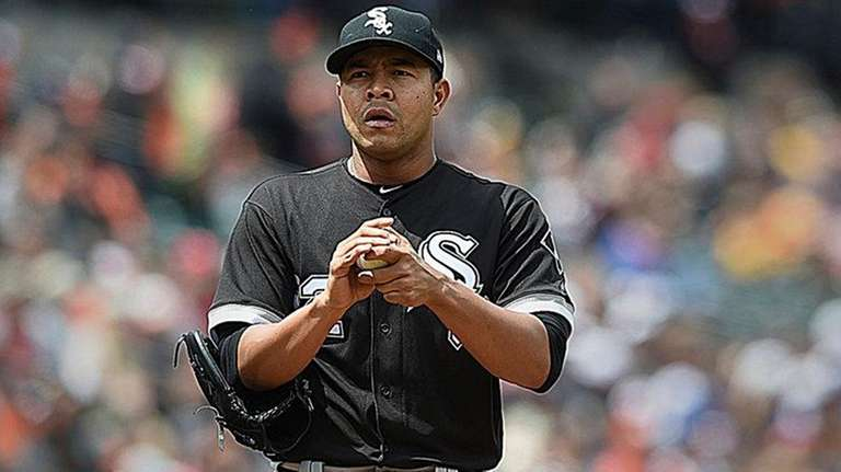 Chicago White Sox starting pitcher Jose Quintana pauses