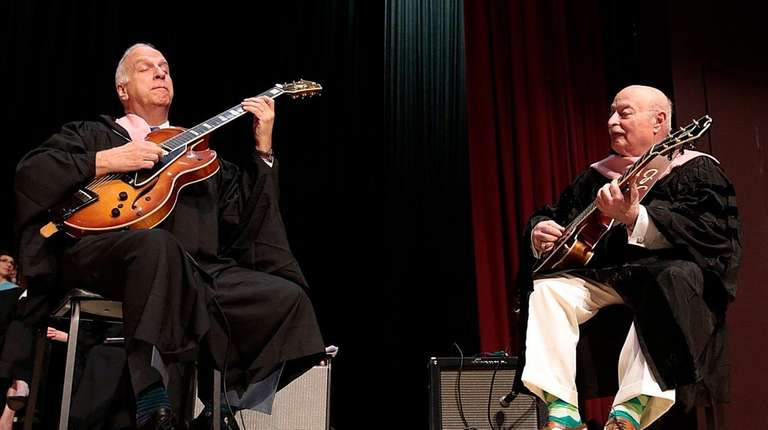 Professor Peter Rogine, left, and guitarist and commencement