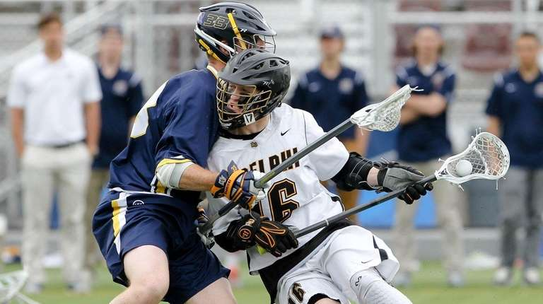 Adelphi's Ian Kirby carries the ball while being