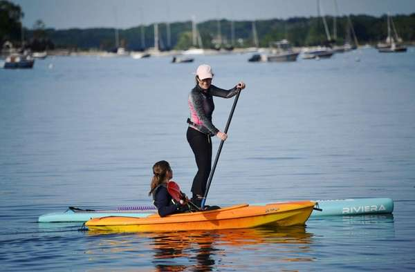 Arlene LaRosa of Oyster Bay paddle boards while