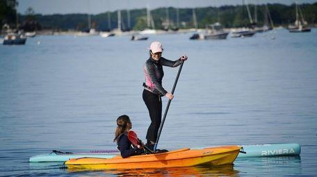 Arlene LaRosa of Oyster Bay paddle boards while