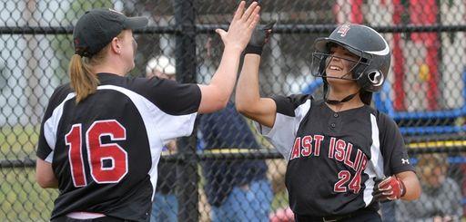 East Islip's Allison Franzese, left, high-fives Allison Dell'Orto