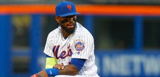Jose Reyes of the New York Mets looks on