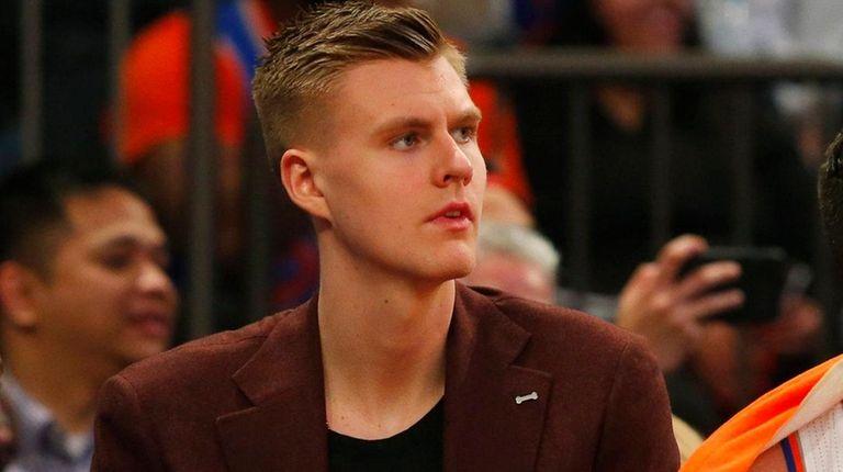 Kristaps Porzingisof the New York Knicks looks on