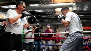 Gennady Golovkin, right, spars with his trainer Abel