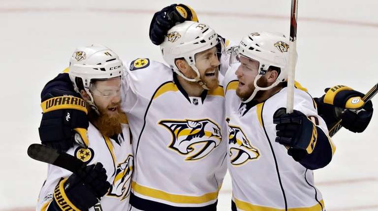 Nashville Predators center Colin Wilson, center, celebrates with