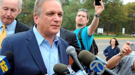 Edward Mangano outside federal court in Central Islip