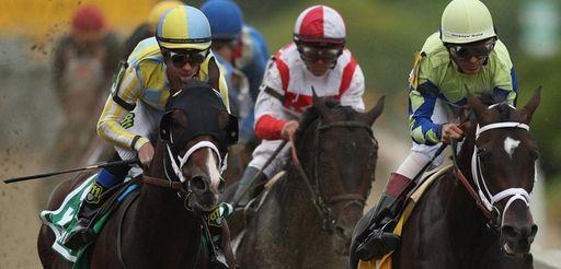Always Dreaming, ridden by John Velazquez, leads the