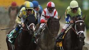 Always Dreaming, ridden by John Velazquez, leads the