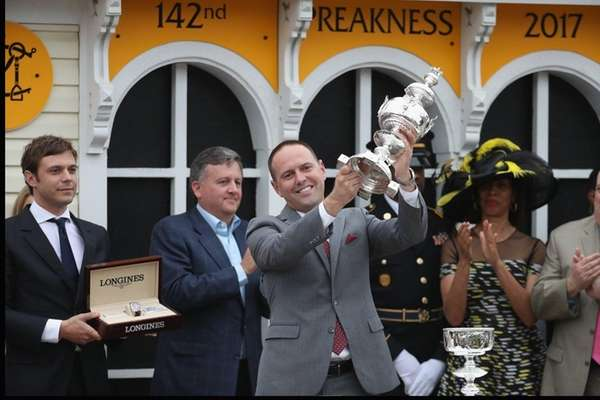 Cloud Computing's trainer Chad Brown celebrates with