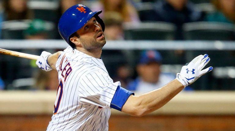 Neil Walker of the New York Mets follows