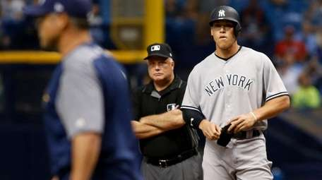 Aaron Judge of the New York Yankees watches,