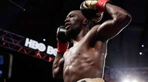 Terence Crawford celebrates after a super lightweight championship