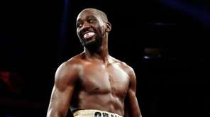 Terence Crawford smiles during the seventh round of