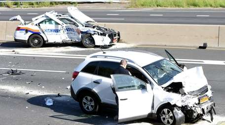 A Nassau highway patrol car and an SUV
