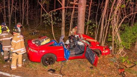 Firefighters at the scene of a crash in