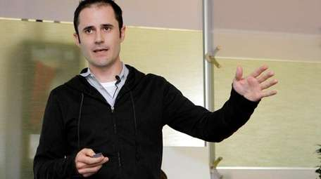 Then-Twitter CEO Evan Williams speaks at the company's