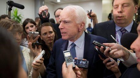 Sen. John McCain (R-Ariz.) speaks to reporters on
