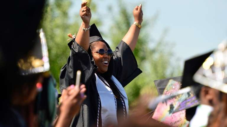A graduating student wears her customized mortarboard during