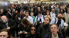 Long Island Rail Road passengers wait for their