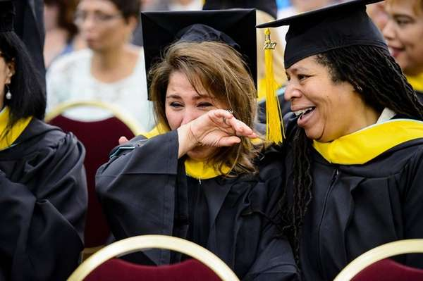 A student becomes emotional during the commencement ceremony