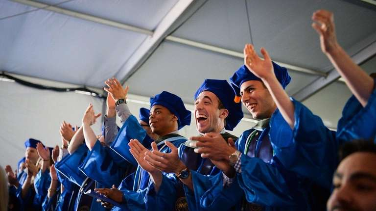 Graduates applaud during the NYIT commencement ceremony on