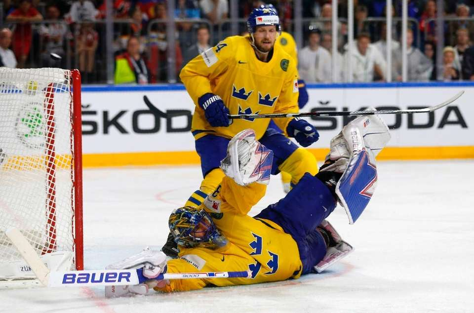 Sweden's goalie Henrik Lundqvist falls down during the