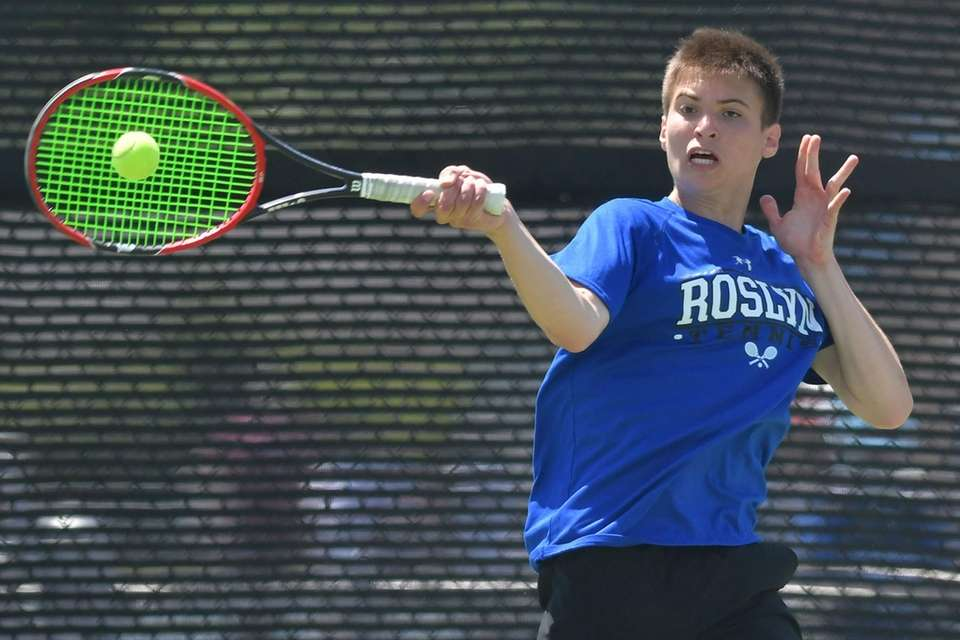 Daniel Weitz of Roslyn returns a volley from