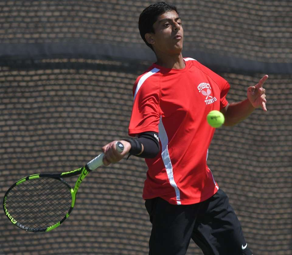 Preet Rajpal of Syosset returns a volley during