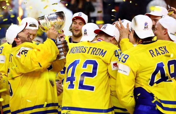 Henrik Lundqvist, goaltender of Sweden lifts the trophy
