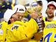 Henrik Lundqvist, goaltender of Sweden lifts the trophy