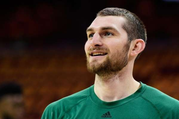 Tyler Zeller of the Celtics warms up prior