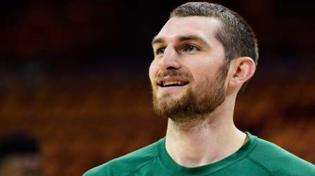 Tyler Zeller of the Celtics warms up prior