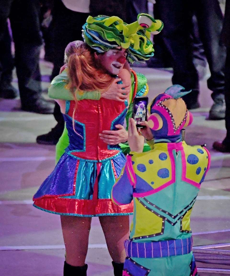 Circus Performers embrace at the close of their