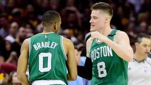 Avery Bradley #0 celebrates with Jonas Jerebko #8