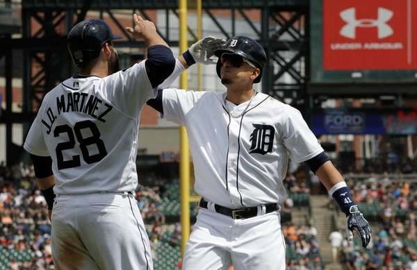 Detroit Tigers designated hitter Victor Martinez, right, is