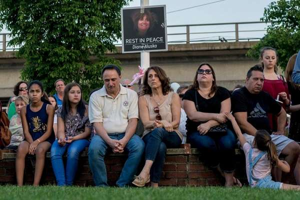 Mourners gather during a candlelight vigil, May 19,