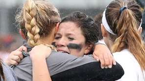 Teammates swarm Long Beach's goalie Sarah Reznick after