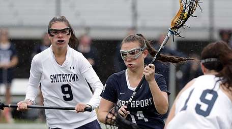 Northport's Nicolle Orella (14) drives between Smithown West's