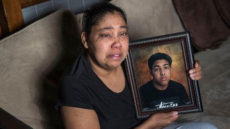 Ivette Perez, of Shirley, cradles a recent photograph
