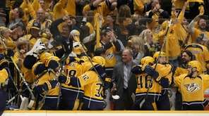 Nashville Predators players and fans celebrate late during