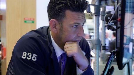 Trader Glenn Kessler works on the floor of